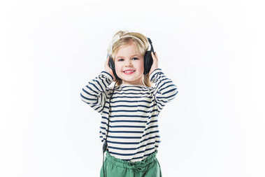 Beautiful little child listening music with headphones isolated on white stock vector