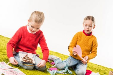 adorable little sisters making diy greeting cards isolated on white