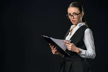 businesswoman working with documents on clipboard, isolated on black
