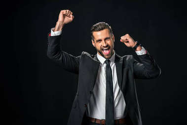 excited successful businessman yelling and celebrating isolated on black