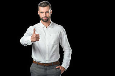 handsome businessman in showing thumb up, isolated on black