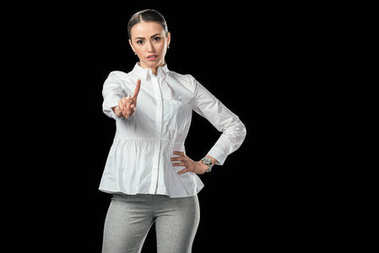young businesswoman pointing up, isolated on black