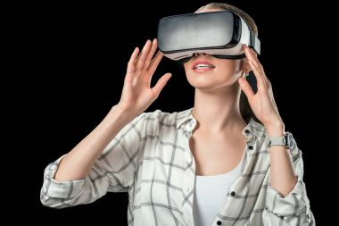 woman using virtual reality headset, isolated on black