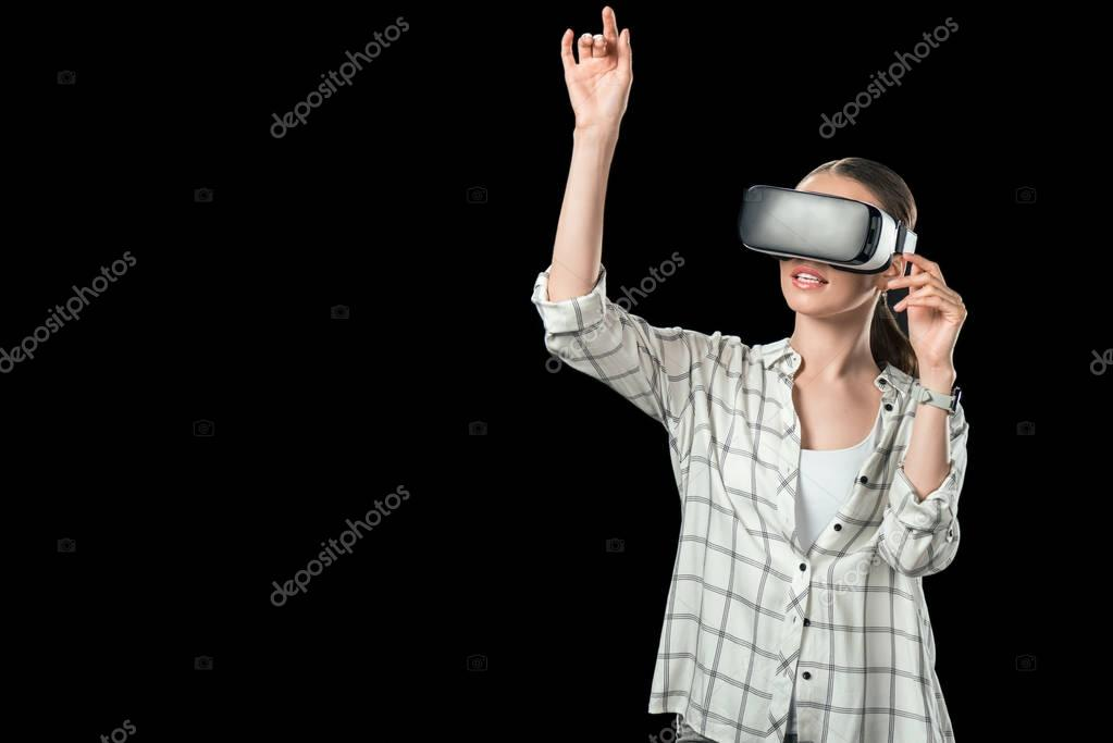 girl gesturing and using virtual reality headset, isolated on black
