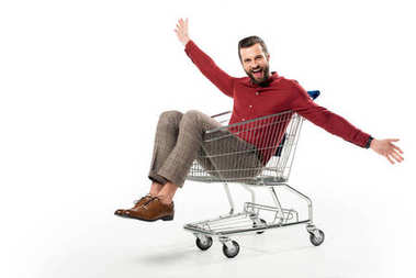 Cheerful man sitting in shopping cart isolated on white stock vector