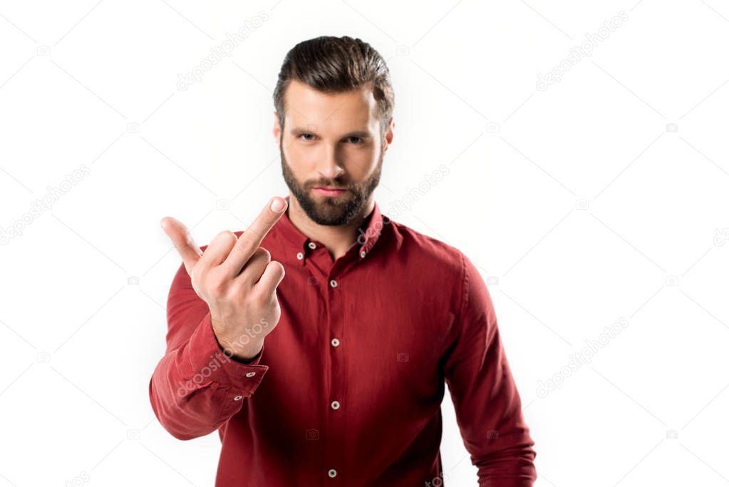 portrait of serious man showing middle finger to camera isolated on white