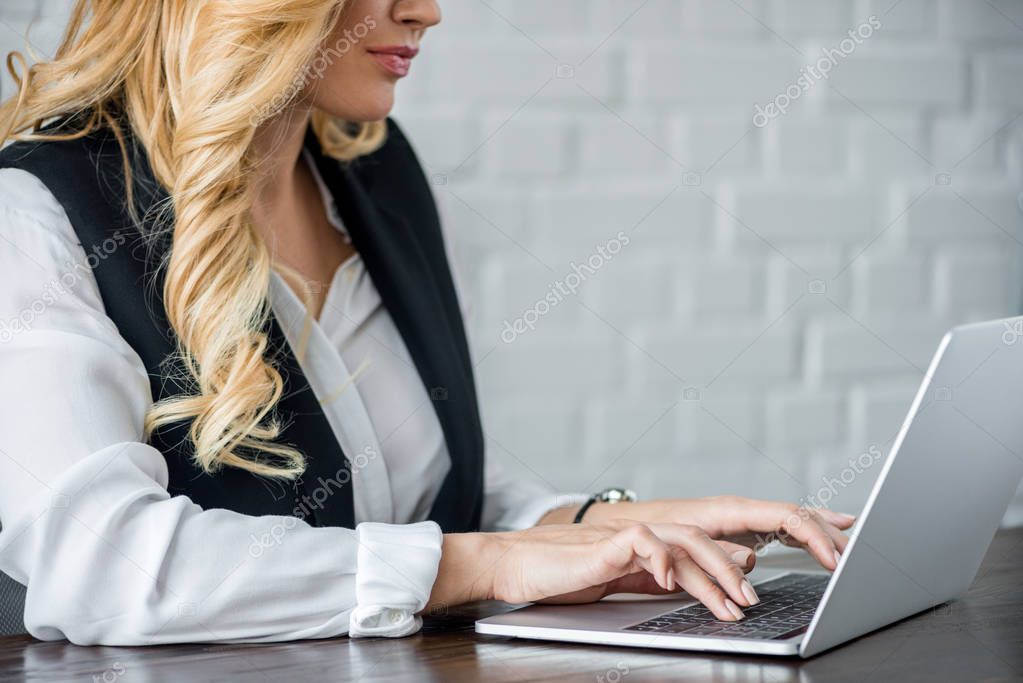 cropped image of businesswoman using laptop