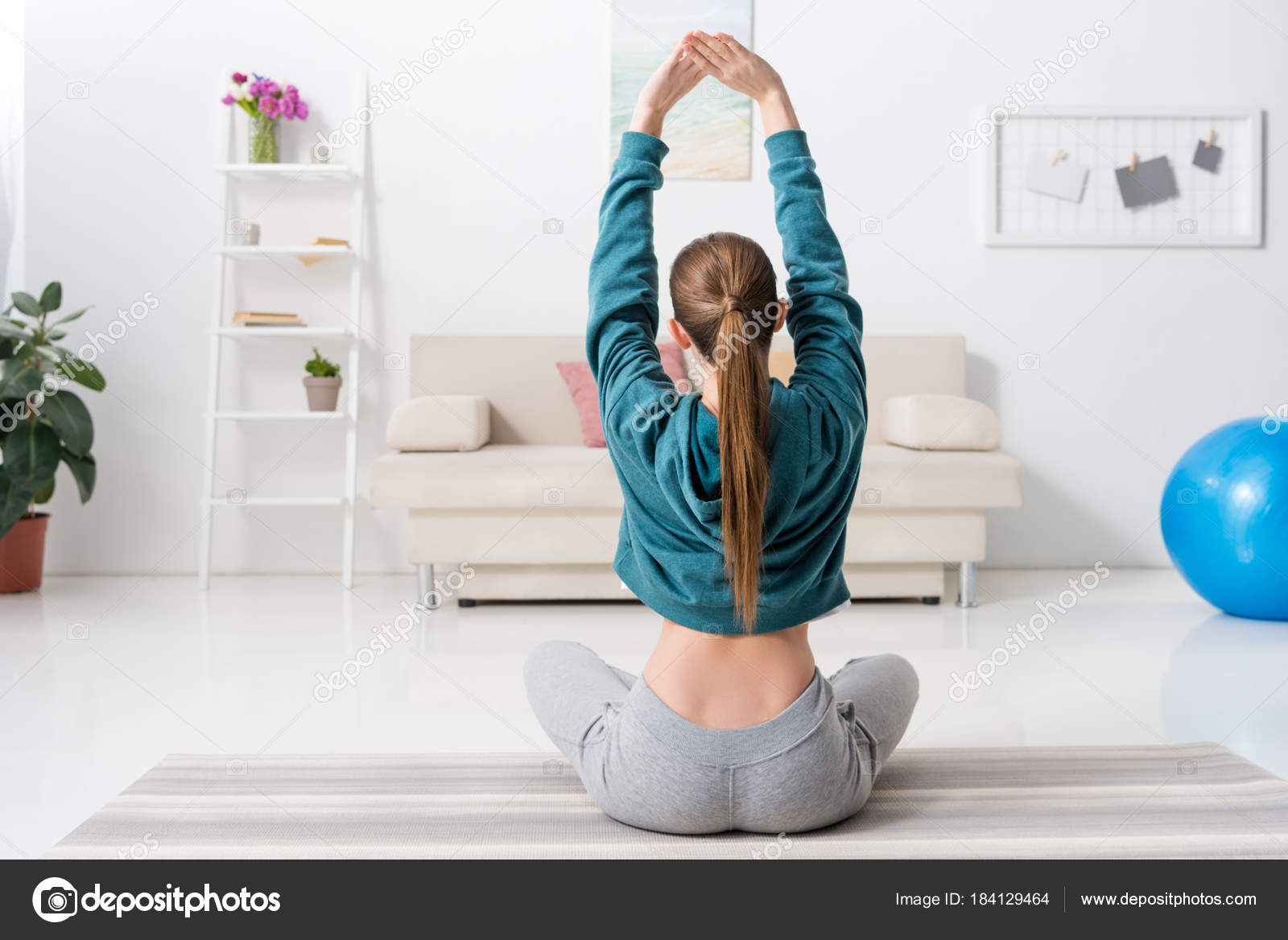 Young Girl Practices Yoga In Parvatasana Lotus Position