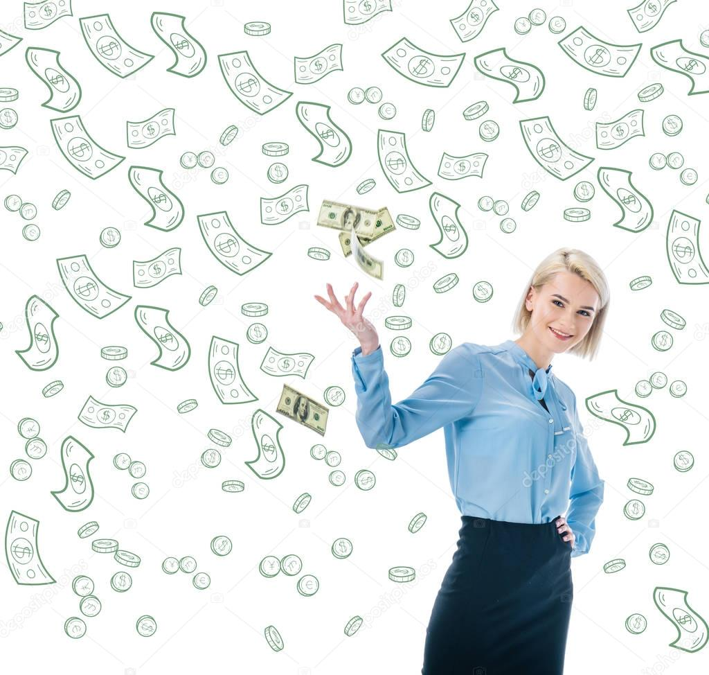 cheerful elegant businesswoman throwing dollar banknotes isolated on white