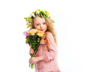 Portrait of kid wearing wreath band and holding bouquet of flowers isolated on white