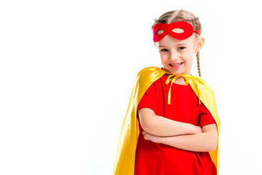 Excited little supergirl wearing yellow cape with red mask for eyes on forehead  isolated on white