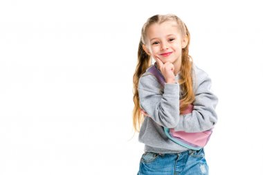 Smiling little child holding finger on chin isolated on white stock vector