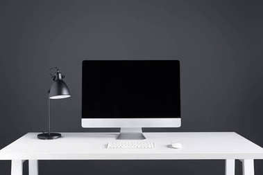 desktop computer with blank screen with keyboard and computer mouse on table