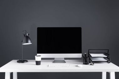 modern desktop computer with blank screen with keyboard and computer mouse at workplace