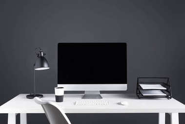 desktop computer with blank screen with keyboard and computer mouse at workplace