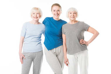 Portrait of three smiling sportswomen isolated on white