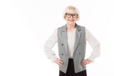 Smiling stylish senior businesswoman in eyeglasses isolated on white