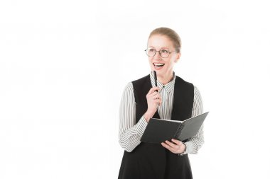 Stylish mature businesswoman in eyeglasses holding pen and textbook isolated on white
