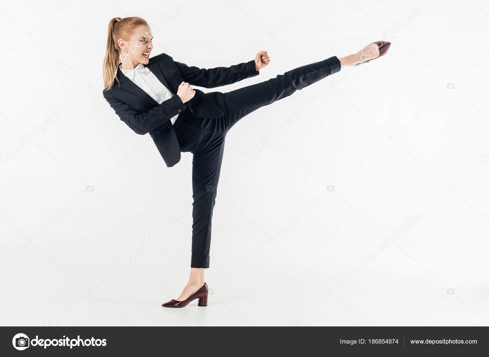 Businesswoman Performing Karate Kick Suit High Heels