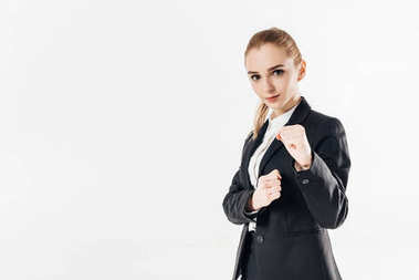 female karate fighter standing in suit and showing fists isolated on white