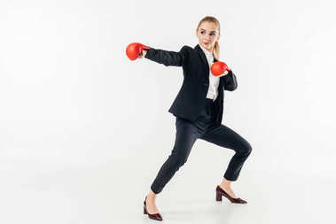 female karate fighter in suit and red gloves isolated on white