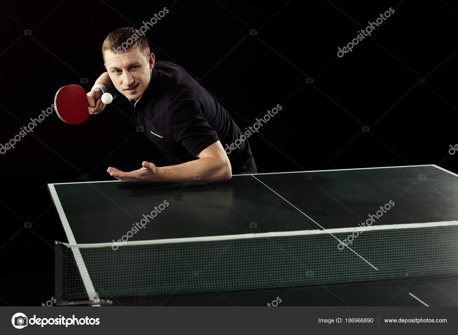 Focused Tennis Player Playing Table Tennis Isolated Black