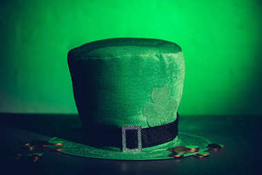 close-up view of green irish hat and golden coins