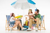 Father with daughter in swimming goggles and mother with water gun isolated on white, travel concept