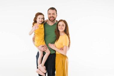 Portrait of smiling stylish family isolated on white