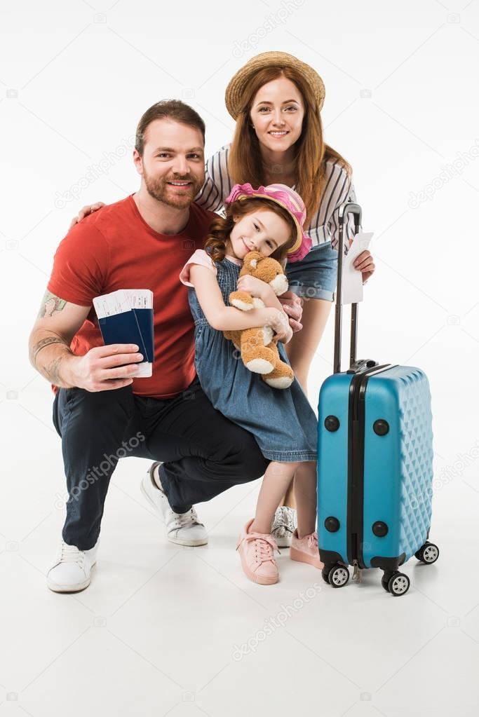 Portrait of happy family of tourists with suitcase isolated on white stock vector