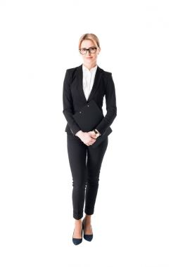 Confident businesswoman in black suit isolated on white