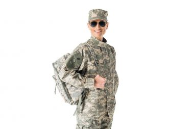 Young army soldier wearing uniform and sunglasses isolated on white stock vector
