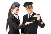 Fotografia Capitano di compagnia aerea e hostess che tiene aereo giocattolo isolato su bianco