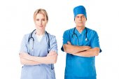 Fotografie Medical crew nurse and doctor in uniform with stethoscopes standing with arms folded isolated on white