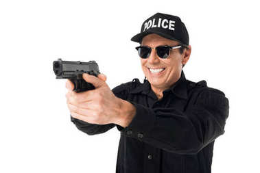 Smiling policeman aiming gun isolated on white