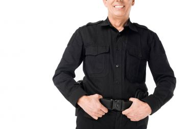 Close-up view of policeman with hands on belt isolated on white