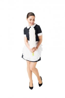 Young maid in professional uniform singing in duster isolated on white