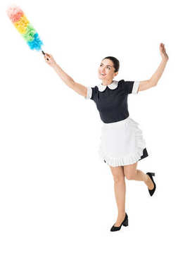 Young maid in professional uniform using colorful duster isolated on white