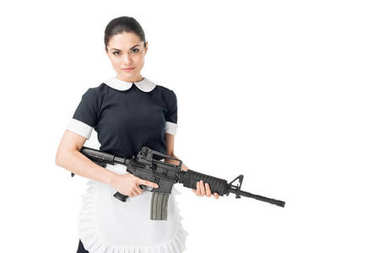 Young maid in uniform holding rifle isolated on white