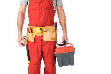 Close-up view of handyman holding toolbox isolated on white