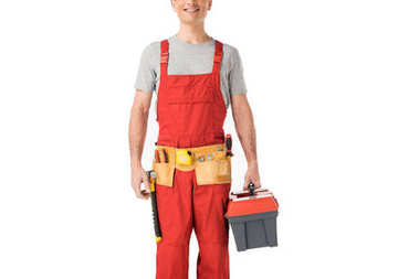 Handsome builder in uniform holding toolbox isolated on white