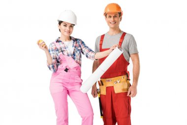 Male and female builders holding blueprint and ruler isolated on white