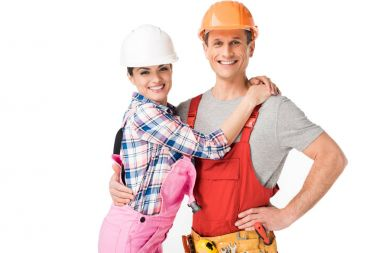 Construction workers team embracing isolated on white