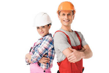 Male and female builders in hardhats and overalls isolated on white stock vector