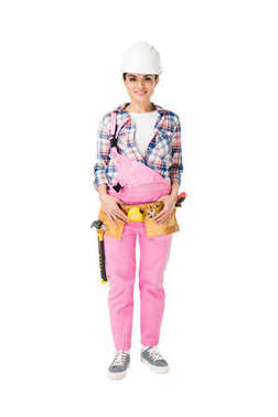 Cheerful female construction worker in pink uniform isolated on white