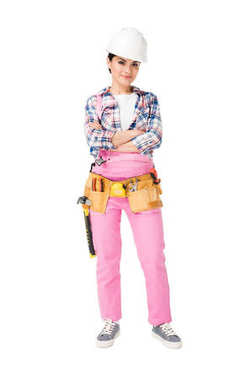 Professional female builder in overalls and hardhat isolated on white