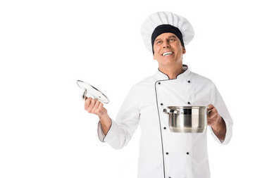 Smiling chef with metal pan in hands isolated on white stock vector