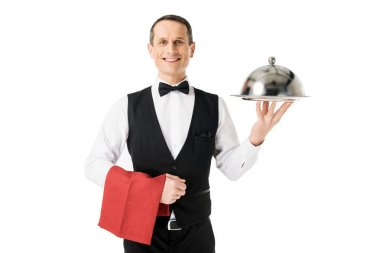 Elegant waiter holding serving tray with cover isolated on white