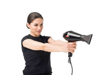 Woman hairdresser aiming with hairdryer isolated on white