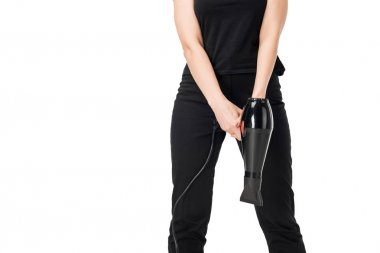 Close-up view of female stylist holding hairdryer isolated on white